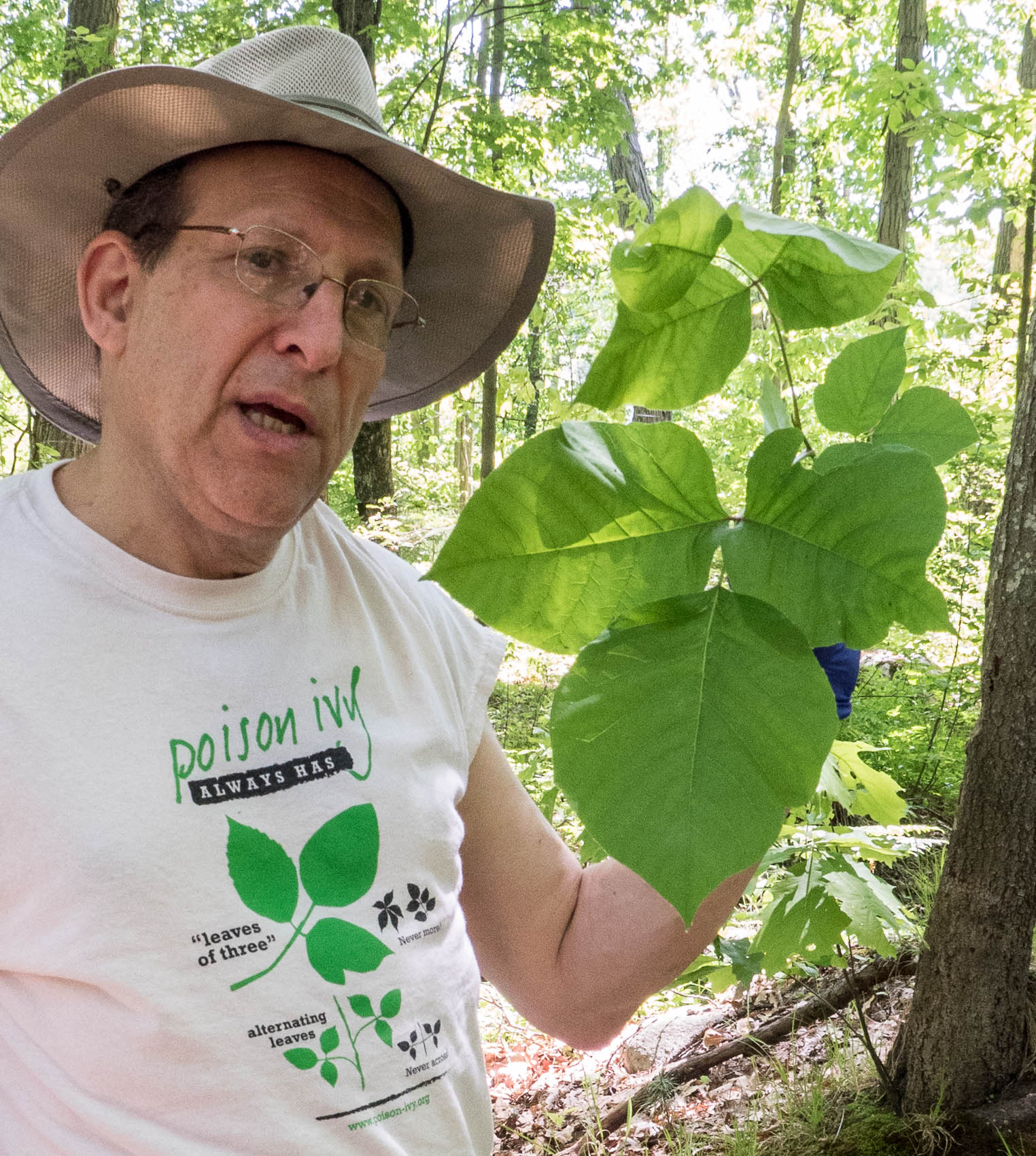 man with very large poison ivy leaf