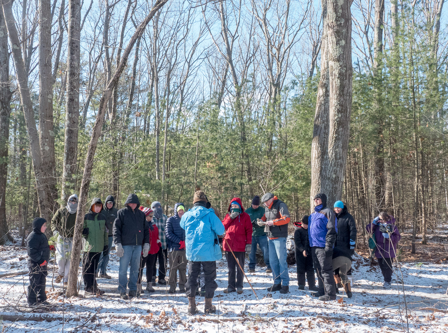 The group gathers for a talk along the Wetland Trail.