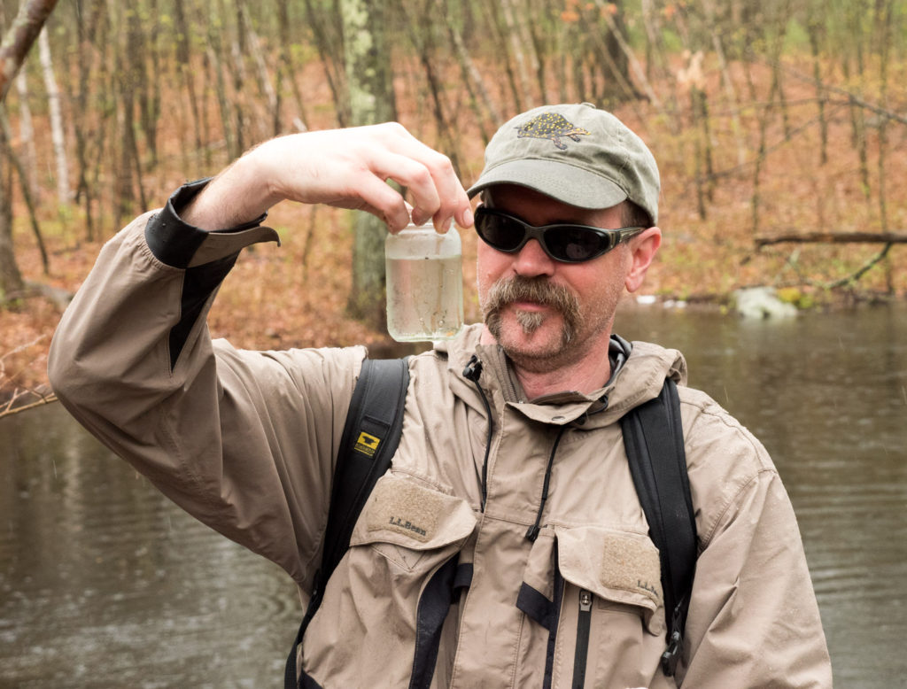 Matt Burne finds life form in vernal pool at Mary Cummings Park
